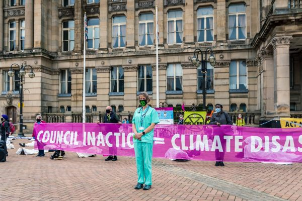 Birmingham, UK. 13 Oct, 2020. Extinction Rebellion protesters carry out action outside the Birmingham City Council highlighting the council's inaction on the climate emergency in Birmingham, UK. Credit: Vladimir Morozov/akxmedia.